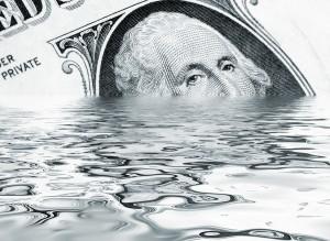 bigstock-Sinking-Dollar-5259163