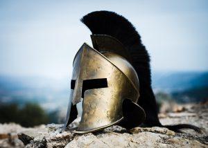Spartan helmet on rocks.